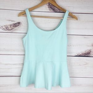T220 Express sleeveless peplum blouse.